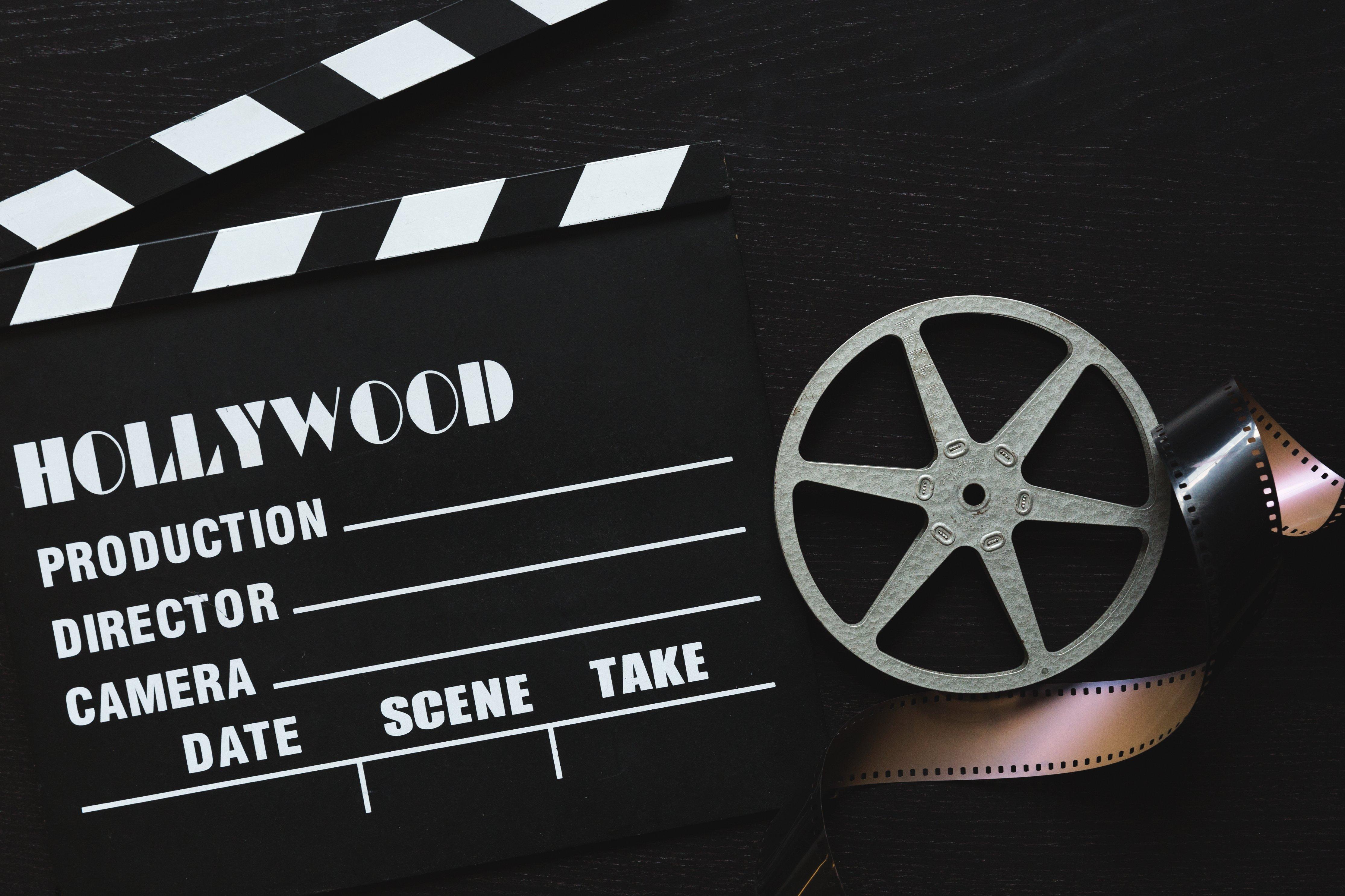 a-movie-clapper-board-film-roll-and-sprocket-wheel.jpg